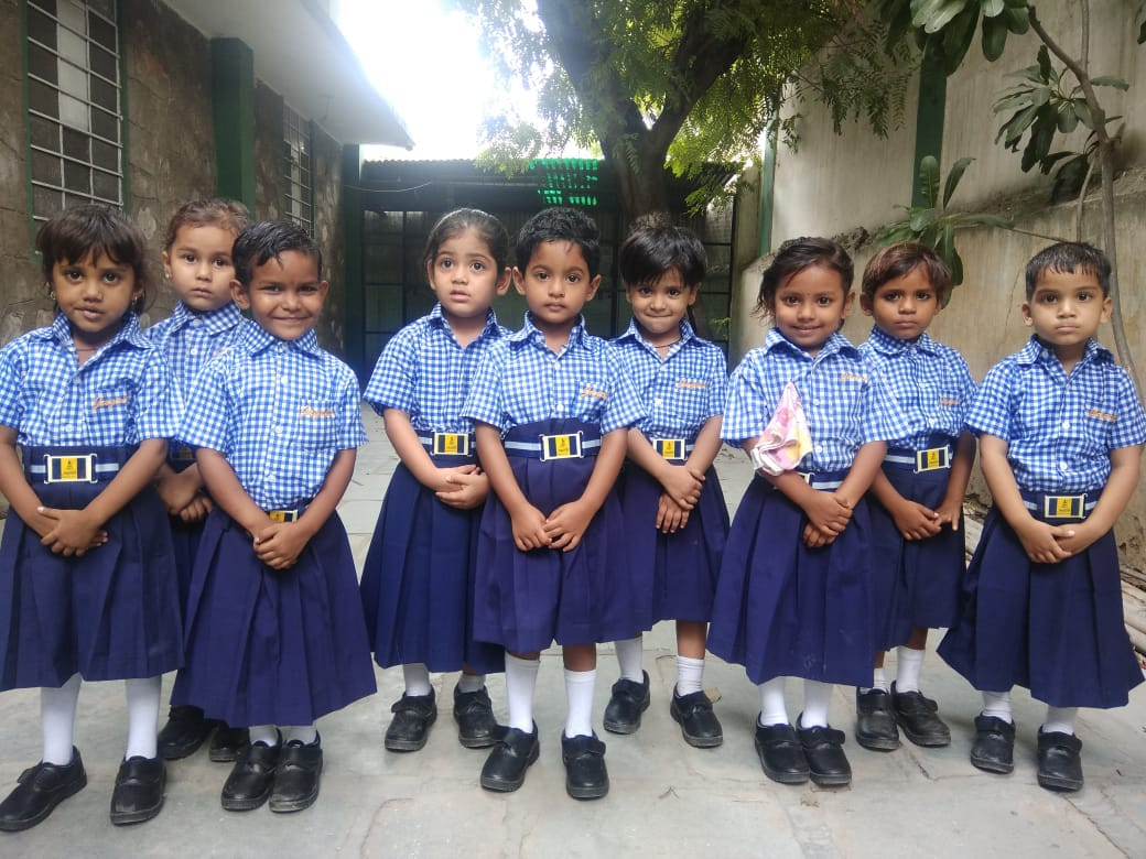Uniform was distributed to the tiny girl children at Jagiti Balika Sadan School, C-Scheme, Jaipur